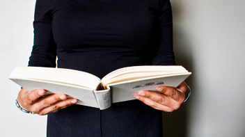 image of woman's hands holding a book
